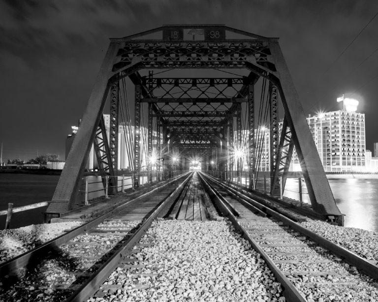 Black and white photo of the bridge to Quaker Oats in Cedar Rapids, Iowa