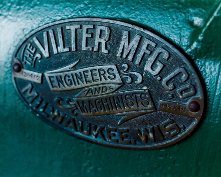 A photo of a Vilter Manufacturing badge that was developed from a roll of film