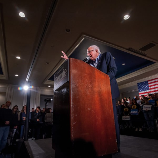 Bernie Sanders speaking to a crowd in Iowa City